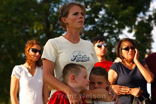 Huntington - Family members of miners missing in the Crandall Canyon coal mine stand with spokesman Sonny Olsen as he reads their statement to the media in the Huntington City Park. The family members wished to remain unidentified..; 8.23.2007