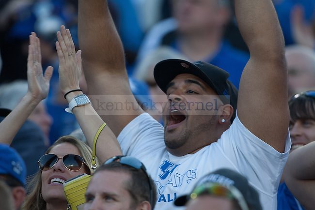 A UK fan cheers during the second half of the Kentucky Wildcats game against the Mississippi State Bulldogs at Commonwealth Stadium on Saturday, October 25, 2014 in Lexington, Ky. Mississippi State defeated Kentucky 45-31. Photo by Adam Pennavaria   Staff