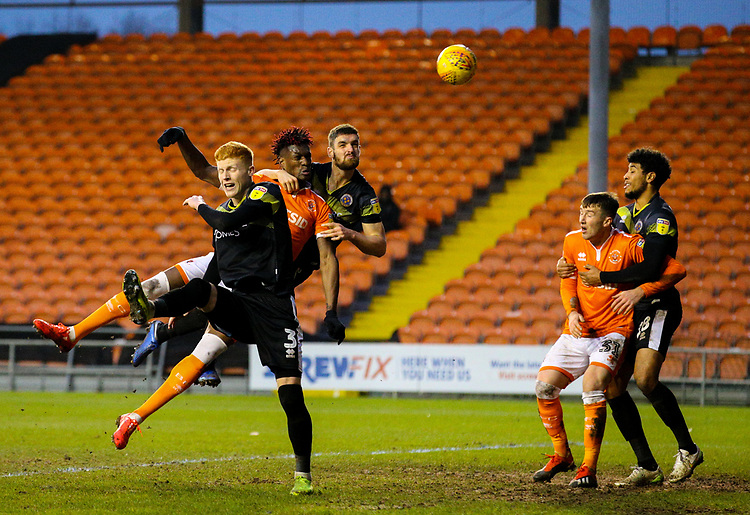 Blackpool's Armand Gnanduillet heads over the bar under pressure from Shrewsbury Town's Luke Waterfall<br /> <br /> Photographer Alex Dodd/CameraSport<br /> <br /> The EFL Sky Bet League One - Blackpool v Shrewsbury Town - Saturday 19 January 2019 - Bloomfield Road - Blackpool<br /> <br /> World Copyright © 2019 CameraSport. All rights reserved. 43 Linden Ave. Countesthorpe. Leicester. England. LE8 5PG - Tel: +44 (0) 116 277 4147 - admin@camerasport.com - www.camerasport.com