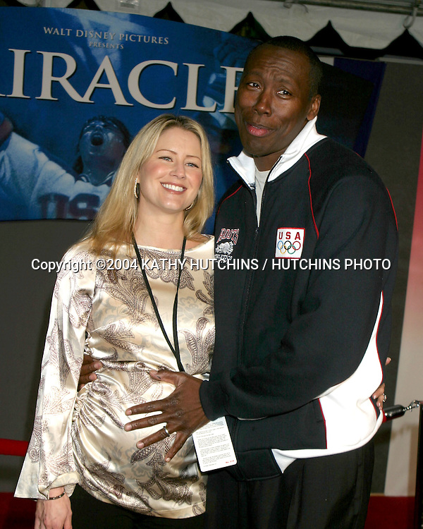 "©2004 KATHY HUTCHINS / HUTCHINS PHOTO.""MIRACLES"" PREMIERE.HOLLYWOOD, CA.FEBRUARY 2, 2004..AL JOYNER.WIFE."