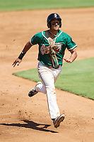 Carlos Lopez (7) of the Greensboro Grasshoppers hustles towards third base against the Kannapolis Intimidators at CMC-NorthEast Stadium on September 1, 2014 in Kannapolis, North Carolina.  The Grasshoppers defeated the Intimidators 7-4.  (Brian Westerholt/Four Seam Images)