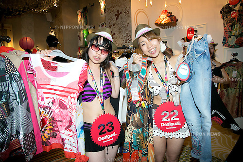 """Tokyo, Japan - Customers in swimsuit pose for cameras inside the Desigual store in Tokyo's Harajuku fashion district. A fashion chain called """"Seminaked Party by Desigual"""" offers the first 100 customers (wearing swimsuit) free clothing items at the grand opening in Tokyo, Japan, June 22, 2013. More than 4,000 people attend the Seminaked Party around the world. (Photo by Rodrigo Reyes Marin/AFLO)"""