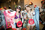 "Tokyo, Japan - Customers in swimsuit pose for cameras inside the Desigual store in Tokyo's Harajuku fashion district. A fashion chain called ""Seminaked Party by Desigual"" offers the first 100 customers (wearing swimsuit) free clothing items at the grand opening in Tokyo, Japan, June 22, 2013. More than 4,000 people attend the Seminaked Party around the world. (Photo by Rodrigo Reyes Marin/AFLO)"