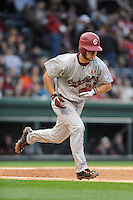 Infielder Max Schrock (22) of the South Carolina Gamecocks runs toward first base in a game against the Furman Paladins on Wednesday, April 3, 2013, at Fluor Field at the West End in Greenville, South Carolina. (Tom Priddy/Four Seam Images)
