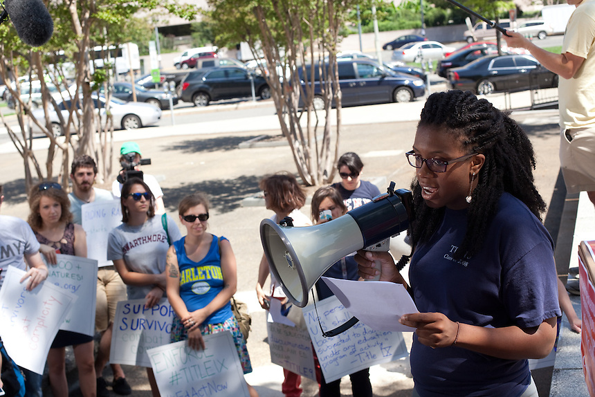 Wagatwe Wanjuki, a former student at Tufts University, addresses a crowd in front of The Department of Education in Washington, DC. Wagatwe is a coordinator for ED ACT NOW. A network of campus sexual assault survivors and<br /> advocates are petitioning Secretary Arne Duncan, U.S. Department of Education (ED), to do more to address sexual violence on<br /> college campuses. In the last few months there has been an unprecedented number of Title IX<br /> complaints filed with the Department of Education&rsquo;s (ED) Office for Civil Rights (OCR) against<br /> colleges. Survivors and advocates gathered in front of ED to deliver a petition demanding it improve enforcement of federal laws addressing sexual violence. July 15, 2013.