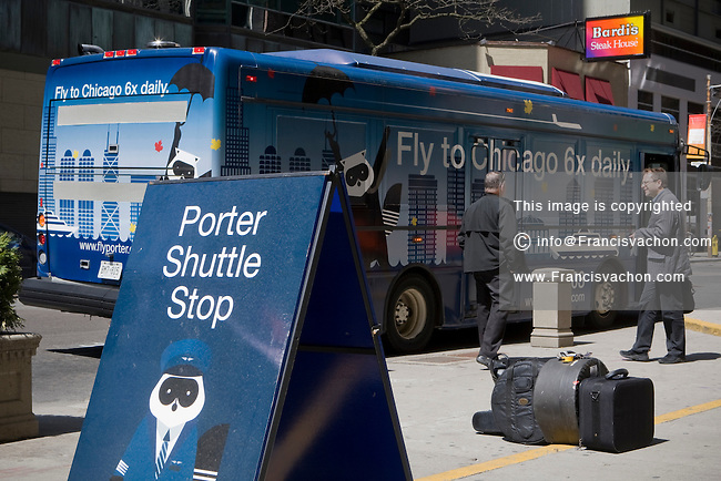 A Porter shuttle bus is seen in downtown Toronto April 22, 2010. Porter Airlines is a regional airline headquartered at Billy Bishop Toronto City Airport on the Toronto Islands in Toronto, Ontario, Canada.