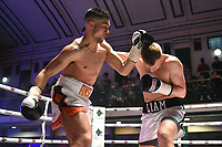 Tom Ansell (white/orange shorts) defeats Liam Wright during a Boxing Show at York Hall on 10th June 2017