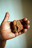 BELIZE, Punta Gorda, Toledo, a man holds an old carved figurine  that was discovered at the ruins of Lubantuun