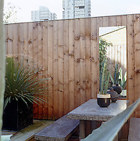 An High fence encloses the garden of this South London home
