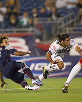 An offside Pumas UNAM forward Martin Bravo (10) heads the ball on net as New England Revolution defender Kevin Alston (30) defends. The New England Revolution defeated Pumas UNAM in SuperLiga group play, 1-0, at Gillette Stadium on July 14, 2010.
