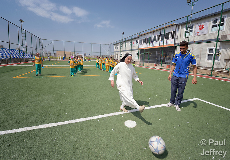 Sister Huda Sheeto kicks a football at the Al Bishara School, which is run by the Dominican Sisters of St. Catherine of Siena in Ankawa, near Erbil, Iraq. Sheeto is the school's principal. <br /> <br /> The students and the Dominican Sisters themselves were displaced by ISIS in 2014. The nuns have established schools and other ministries among the displaced.