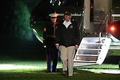 US President Donald J. Trump walks off Marine One on the South Lawn of the White House returning from California after viewing damage from that state's wildfires in Washington, DC, USA,18 November 2018. Seventy-four people have been killed and more than 1,000 people are missing due to multiple devastating fires across the state.<br /> Credit: Tasos Katopodis / Pool via CNP