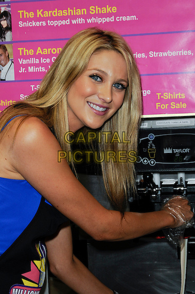 STEPHANIE PRATT.creates her Slumber Party Milkshake at Millions of Milkshakes in West Hollywood, California, USA,.January 9th, 2010..half length  apron black blue smiling .CAP/ROT.©Lee Roth/Capital Pictures.