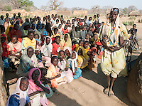 A school teacher and her class in the Nuba tribe village of Nyaro, Kordofan region, Sudan