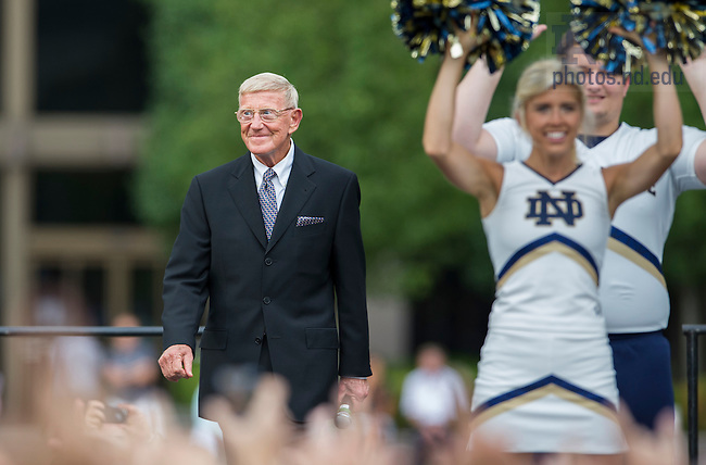 Sept. 5, 2014; Former head football coach Lou Holtz smiles as students and fans welcome him on stage during the pep rally before the game against Michigan. (Photo by Barbara Johnston/ University of Notre Dame)