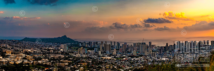 Sunset over Diamond Head, Waikiki and downtown Honolulu, O'ahu.