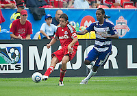 July 24, 2010 Toronto FC defender Nick Garcia #4 and FC Dallas forward/midfielder Atiba Harris #16 in action during a game between FC Dallas and Toronto FC at BMO Field in Toronto..Final score was 1-1.