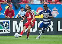 July 24, 2010 Toronto FC defender Nick Garcia #4 and FC Dallas forward/midfielder Atiba Harris #16 in action during a game between FC Dallas and Toronto FC at BMO Field in Toronto..Final score was 1-1.