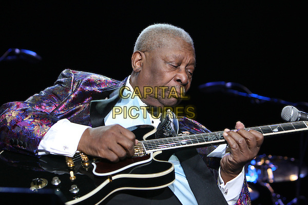 B.B. KING (born Riley B. King).Performing live at the Wembley Arena, London, England..June 28th, 2009.stage concert live gig performance music half length purple pink pattern suit jacket guitar .CAP/MAR.© Martin Harris/Capital Pictures.