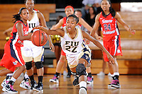 25 February 2012:  FIU guard Jerica Coley (22) recovers a loose ball in the first half as the FIU Golden Panthers defeated the University of South Alabama Jaguars, 58-55 (OT), at the U.S. Century Bank Arena in Miami, Florida.  Coley scored 25 points, and is currently the third leading scorer in NCAA Division I basketball.