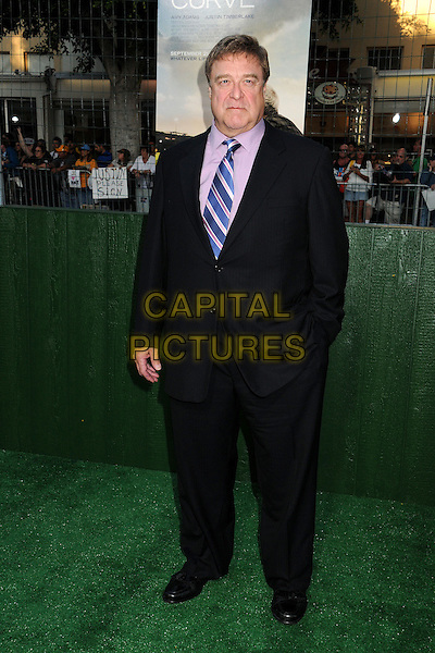"John Goodman.""Trouble With The Curve"" Los Angeles Premiere held at the Regency Village Theatre, Westwood, California, USA..September 19th, 2012.full length suit black blue tie pink shirt hand in pocket.CAP/ADM/BP.©Byron Purvis/AdMedia/Capital Pictures."