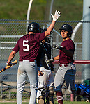 NAUGATUCK , CT-072920JS04—Naugatuck's Jonathan Chatfield  (17) is congratulated at home plate by teammate Mark Nofri (5) while coming in to score a run during their CT Elite Baseball Association's game against Bethel Wednesday at Naugatuck High School. <br />  Jim Shannon Republican-American