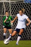 Seattle Reign FC goalkeeper Michelle Betos (18) shouts instructions to defender Elli Reed (7). Sky Blue FC defeated the Seattle Reign FC 2-0 during a National Women's Soccer League (NWSL) match at Yurcak Field in Piscataway, NJ, on May 11, 2013.