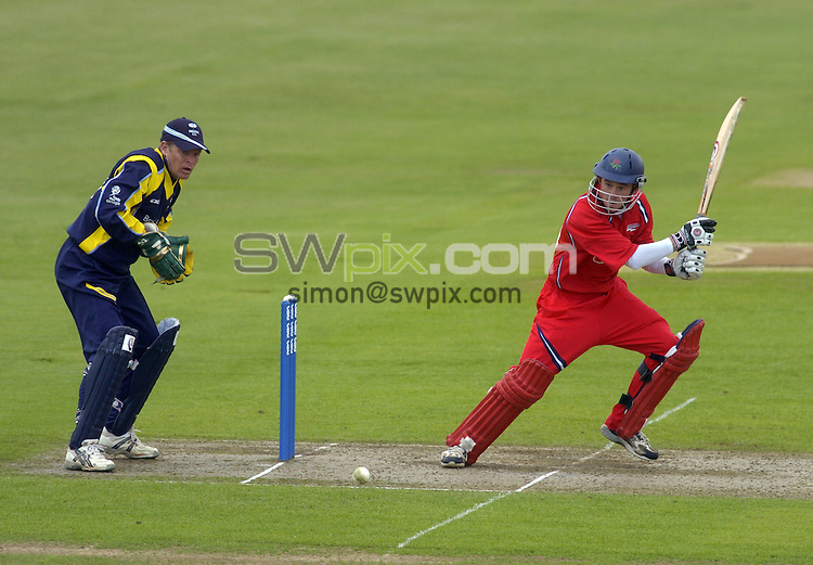 Picture by Chris Whiteoak/SWPIX.COM, C and G Trophy, Yorkshire v Lancashire, 28/05/06..Copyright>>Simon Wilkinson>>07811267706..Lancashire's Gareth Cross makes more runs Yorkshire Gerard Brophy in pic