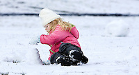 SEYMOUR, CT- 14 JAN 2008- 011408JT10-.Lily Desautels, 3, of Seymour, builds a pile of snow as she sings Barney songs to herself at Chatfield Park in Seymour on Monday after a snow storm dropped several inches of snow in the area. .Josalee Thrift / Republican-American