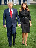 United States President Donald J. Trump and first lady Melania Trump hold hands as they walk down the South Lawn of the White House to observe a moment of silence at 8:46am EDT in commemoration of  the 18th anniversary of the terrorist attacks on the World Trade Center in New York, NY and the Pentagon in Washington, DC on Wednesday, September 11, 2019.<br /> Credit: Ron Sachs / CNP /MediaPunch