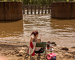 May 5, 2018. Fayetteville, North Carolina.<br /> <br /> Shannon Page fishes at the William O Huske Dam on the Cape Fear River. This is the dam closest to the Chemours plant.<br /> <br /> The Chemours Company, a spin off from DuPont, manufactures many chemicals at its plant in Fayetteville, NC. One of these, commonly referred to as GenX, is part of the process of teflon manufacturing. Chemours has been accused of dumping large quantities of GenX into the Cape Fear River and polluting the water supply of city's down river and allowing GenX to leak into local aquifers.