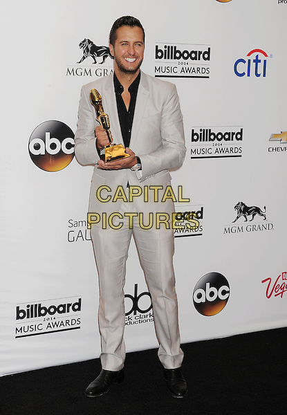 LAS VEGAS, CA- MAY 18: Singer/musician Luke Bryan poses in the press room at the 2014 Billboard Music Awards at the MGM Grand Garden Arena on May 18, 2014 in Las Vegas, Nevada.<br /> CAP/ROT/TM<br /> &copy;Tony Michaels/Roth Stock/Capital Pictures