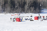 Trent Herbst passes spectators and picnicers on Long Lake in Willow, Alaska duirng the re-start of the 2011 Iditarod.