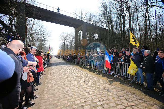Huge crowds await the arrival of the riders at the notorious pave section in the Arenberg Forest during the 111th edition of the 2013 Paris-Roubaix cycle race, France 7th April2013 (Photo by Eoin Clarke 2013)