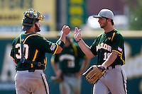 Baylor Bears catcher Josh Ludy #30 celebrates with teammate Logan Vick #19 after the NCAA Regional baseball game against Oral Roberts University on June 3, 2012 at Baylor Ball Park in Waco, Texas. Baylor defeated Oral Roberts 5-2. (Andrew Woolley/Four Seam Images)