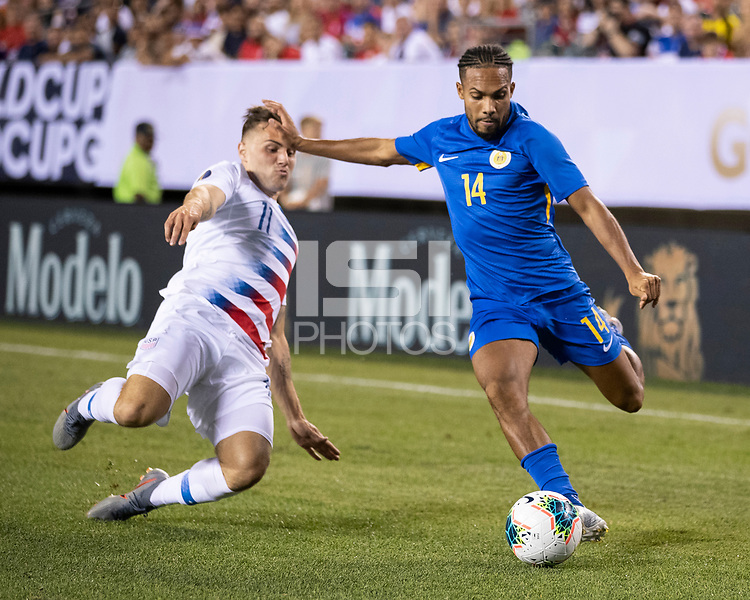 PHILADELPHIA, PA - JUNE 30: Kenji Gorre #14 attacks as Jordan Morris #11 defends during a game between Curaçao and USMNT at Lincoln Financial Field on June 30, 2019 in Philadelphia, Pennsylvania.