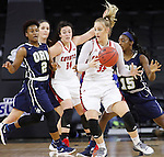 SIOUX FALLS, SD - MARCH 7:  Nicole Seekamp #35 of South Dakota dribbles past Jordan Doyle #2 and Faith Ihim #15 of Oral Roberts and Kate Liveringhouse #34 of South Dakota in the 2016 Summit League Tournament. (Photo by Dick Carlson/Inertia)