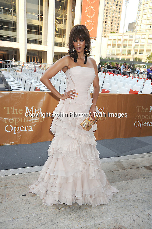 "Tyra Banks in Roberto Cavalli beige dress attends The Metropolitan Opera Fall Gala Opening Night on September 26, 2011 at The Metropolitan Opera House in Lincoln Center, New York City. The production is ""Anna Bolena."""