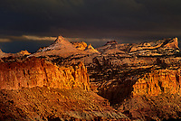 731350034 storm light dapples the sandstone formations of the waterpocket foldl in capitol reef national park in utah