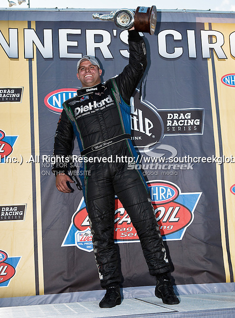 Funny Car Champion Matt Hagen #2814, driver for Diehard Charger's Funny Car in the Winners Circle with his Walley Trophy at the O'Reilly Fall Nationals held at the Texas Motorplex in  Ennis, Texas.