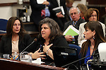 From left, Bridgette Denison, Lauren Denison and Jayann Sepich testify in a Senate Judiciary hearing at the Legislative Building in Carson City, Nev., on Thursday, March 14, 2013. The women are urging lawmakers to support a bill that would require anyone arrested for a felony to submit a DNA sample. The bill, commonly known as Brianna's Law, is named after Bridgette Denison's 19-year-old daughter who was murdered in Reno, Nev., in 2008. Bill sponsors Assemblyman Pat Hickey, R-Reno, and Sen. Debbie Smith, D-Sparks, are at rear..Photo by Cathleen Allison