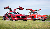 BNPS.,co.uk (01202 558833)<br /> Pic: SilverstoneAuctions/BNPS<br /> <br /> 56 years apart - Iconic 1954 and 2010 Mercs snapped up at auction...<br /> <br /> British collecter in Million pound double swoop on two super rare 'Gullwing' Mercedes at classic car auction.<br /> <br /> Two distinctive Mercedes 'Gullwing' cars have sold for over £1m - to the same buyer.<br /> <br /> One of the motors was a classic 1954 coupe, the Mercedes SL300 Gullwing, that went under the hammer for a whopping £832,000.<br /> <br /> The other, a modern 2010 Mercedes SLS AMG which had done only 690 miles, fetched over £203,000.<br /> <br /> The Mercedes SL300 Gullwing was an instant hit on its release thanks in part to its iconic lifting doors.<br /> <br /> Around 1,400 Gullwings were made between 1954 and 1963, the vast majority of which were exported to the US.