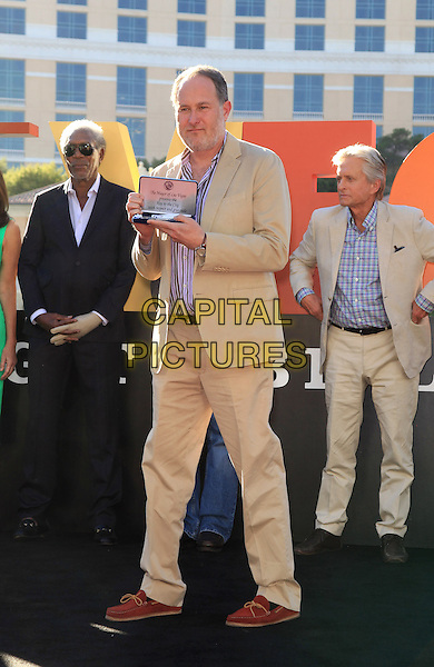 Jon Turteltaub<br /> &quot;Last Vegas&quot; cast received the key to Vegas at the Bellagio Fountain, Las Vegas, NV, USA, 18th October 2013.<br /> full length beige suit award <br /> CAP/ADM/MJT<br /> &copy; MJT/AdMedia/Capital Pictures