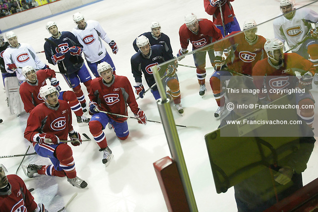 Montreal Canadiens coach Jacques Martin writes on a board as players look on during a practice in Clermont, 150km East of Quebec City, Wednesday October 6, 2010.