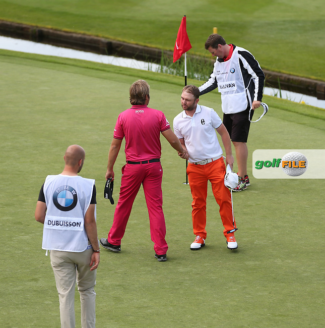 Andy Sullivan (ENG) winks at Victor Dubuisson (FRA) during Round Two of the 2015 BMW PGA Championship over the West Course at Wentworth, Virginia Water, London. 22/05/2015Picture David Lloyd, www.golffile.ie.