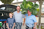 green crown<br /> Tadgh and John Kerins, Blennerville and Pa Walsh, Tralee enjoying the Castlegregory summer festival parade last Sunday evening.