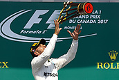 June 11th 2017, Circuit Gilles Villeneuve, Montreal Quebec, Canada; Formula One Grand Prix, Race Day. #44 Lewis Hamilton (GBR, Mercedes AMG Petronas F1 Team),on the podiuk throws his trophy high in celebrations