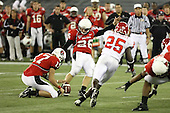 January 5th, 2008:  Ball State place kicker Ian McGarvey (26) kicks a 32  yard field goal as Tanner Justice (17) holds and Rutgers Jason McCourty (25) applies pressure during the second quarter of the International Bowl at the Rogers Centre in Toronto, Ontario Canada...Rutgers defeated Ball State 52-30.  ..Photo By:  Mike Janes Photography