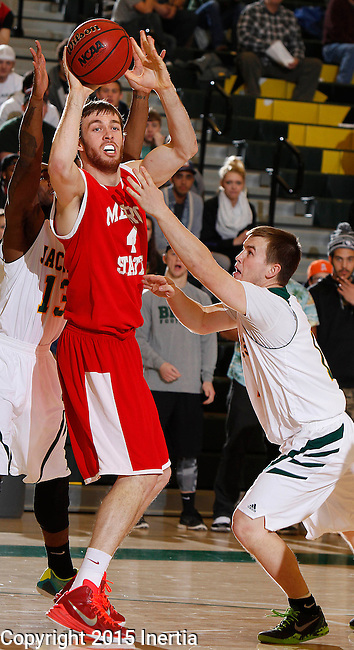 JANUARY 31, 2015 -- Nicholas Kay #4 of Metro State gets past Wyatt Krogman #11 of Black Hills State during their Rocky Mountain Athletic Conference men's basketball game Saturday evening at the Donald E. Young Center in Spearfish, S.D.  (Photo by Dick Carlson/Inertia)