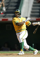 Miguel Tejada of the Oakland Athletics bats during a 2002 MLB season game against the Los Angeles Angels at Angel Stadium, in Anaheim, California. (Larry Goren/Four Seam Images)